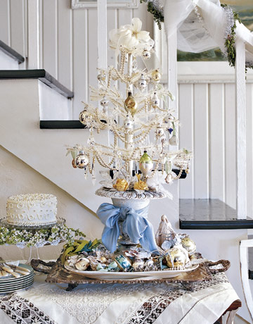 feathers and pearls decorate a tree