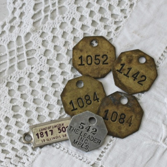 old metal numbered tags