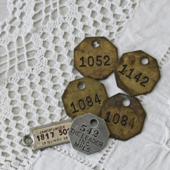 old metal numbered tags