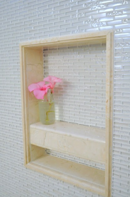 Cutout in shower perfect for holding shampoo and soap