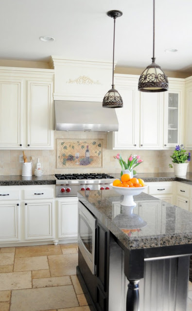 Complete DIY Kitchen remodel with painted cabinets, crown added to the tops, island built out and so much more