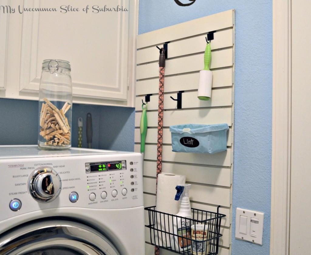 Organized laundry room using slat wall
