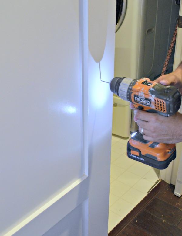 Install pulls on barn door