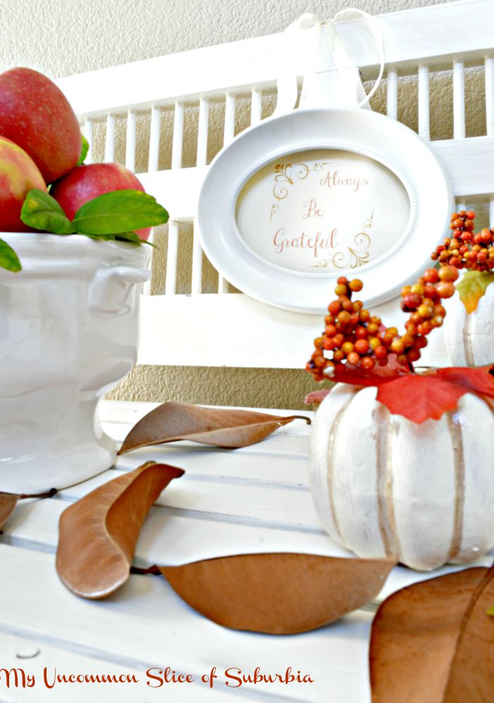 Fall Vignette using fresh apples, painted pumpkins and fallen leaves