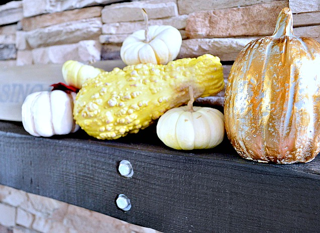 Guards and pumpkins stacked for a great fall vignette