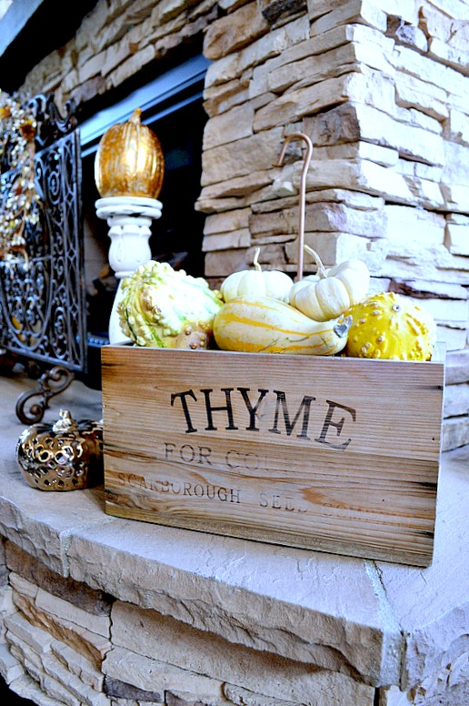 Rustic fireplace decorated for fall, love the wooden box of guards