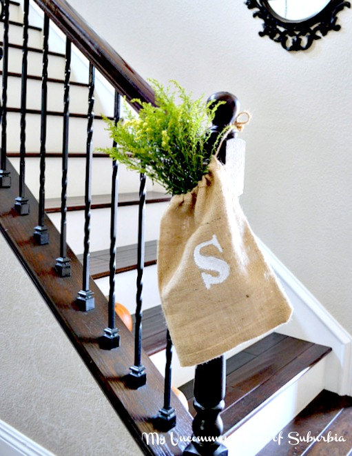 A burlap bag filled with greens, such a easy way to dress up a stairs!