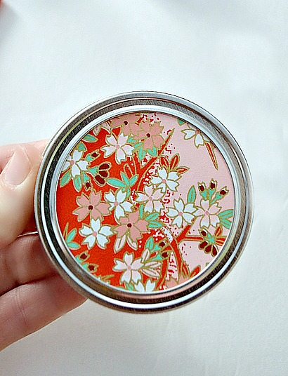 Apply scrap paper on top of mason jar lids to dress them up a bit.