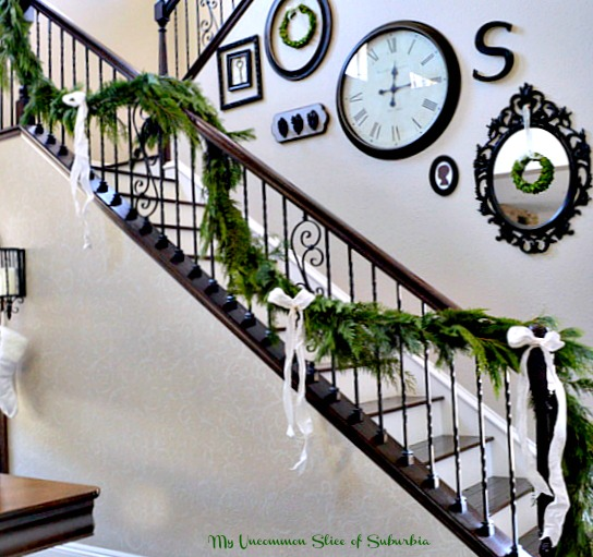Fresh Christmas Garland heading up the stairs for Christmas, very pretty