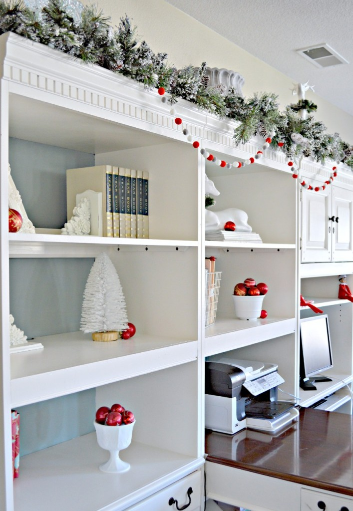 Office Bookshelves decorated for Christmas, love the white and red together!