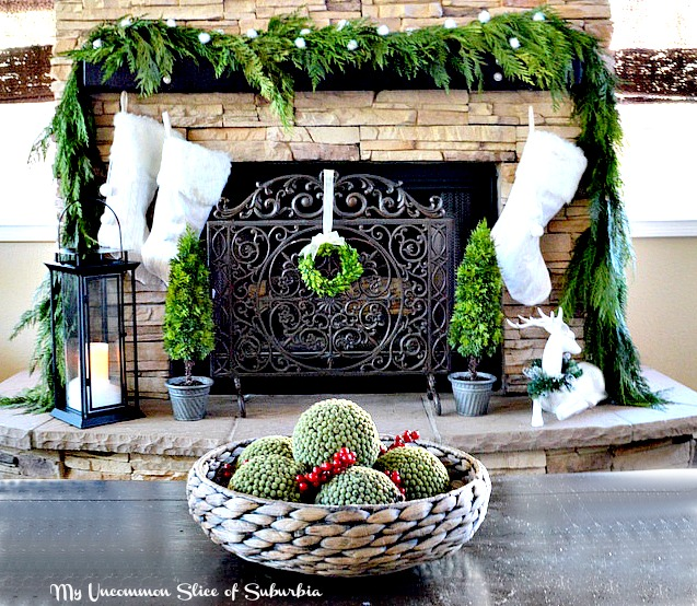 Rustic Fireplace with fresh garland and knitted stockings