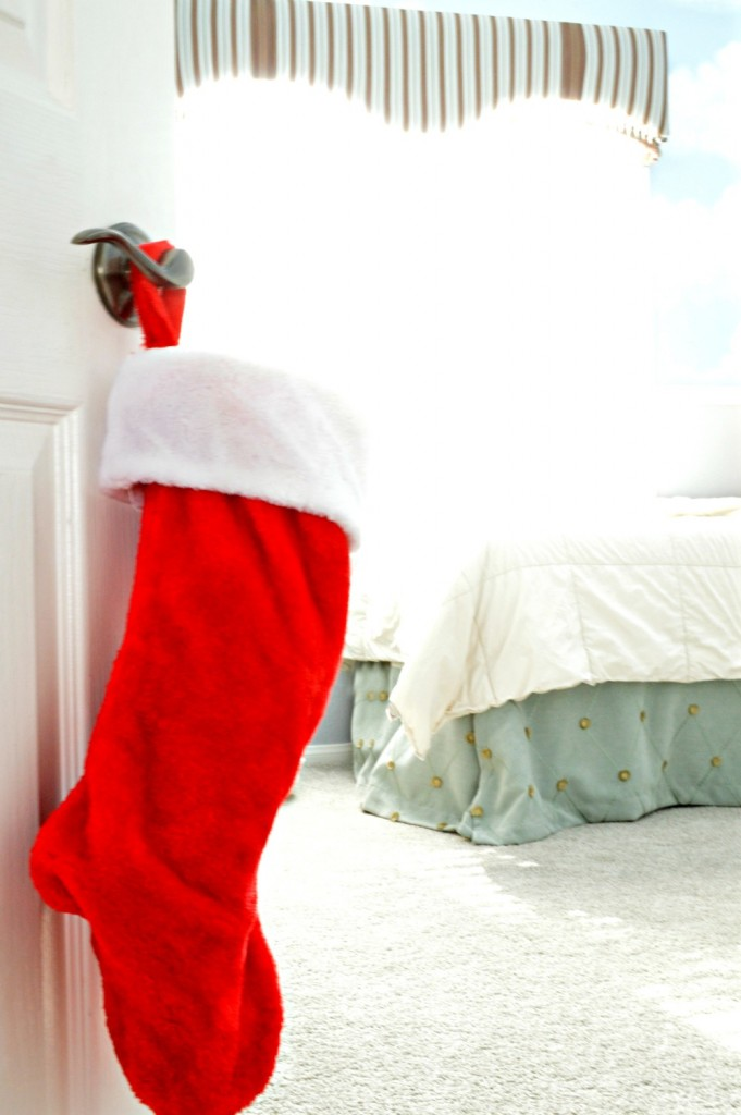 Simple Decoration with christmas stocking on outside of door for kids room
