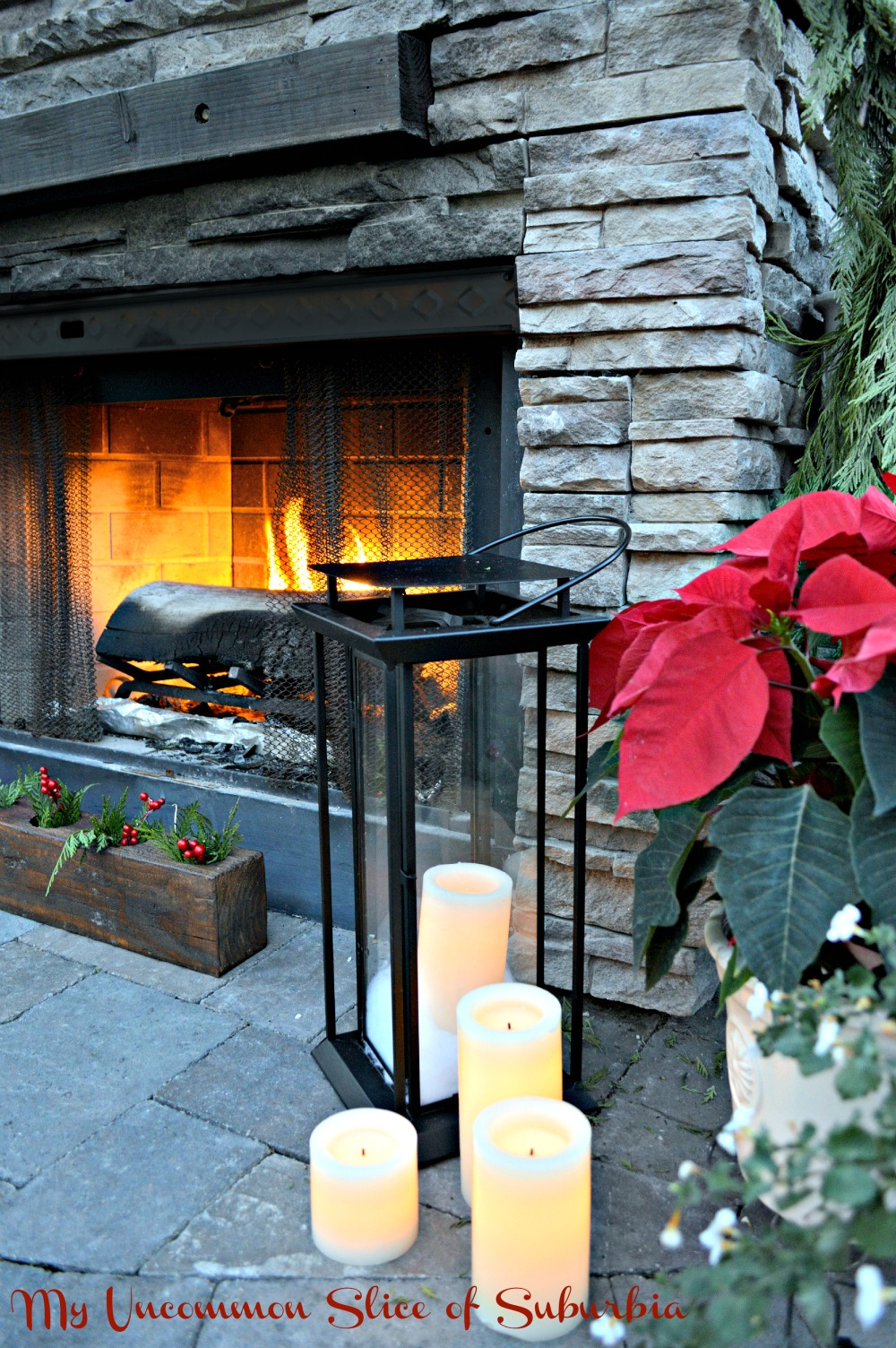 Stacked Stone Outdoor Fireplace with Lanterns and Candles
