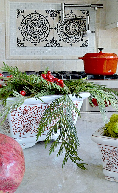 Use Fresh greens and place them into pretty containers for an easy christmas vignette