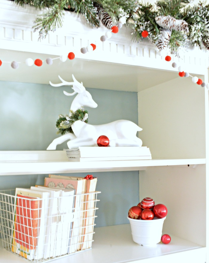 White reindeer with red ornaments, so pretty
