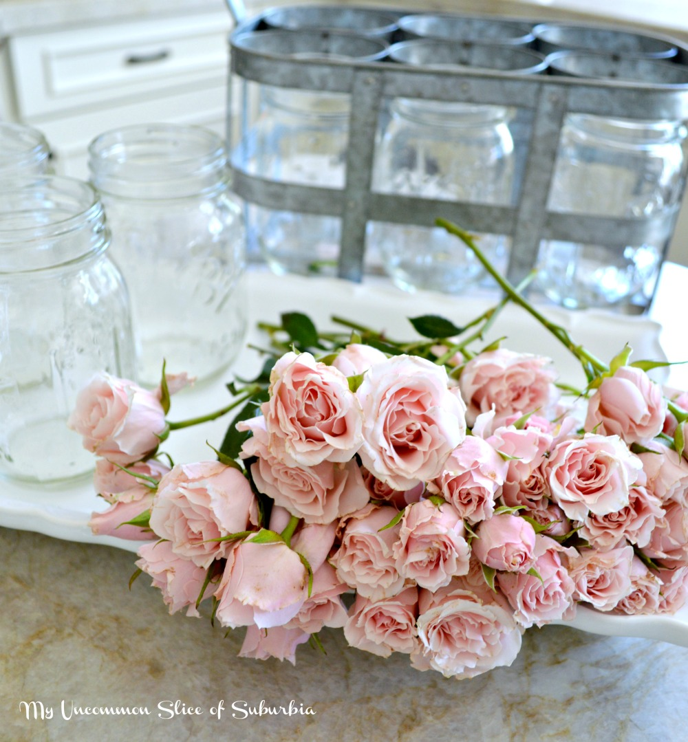 Mason jars and petite roses make for a beautiful and quick display anywhere in your home