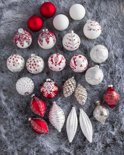 These hand-painted glass ornaments feature delicate hues of white, red, and silver, they are absolutely stunning!
