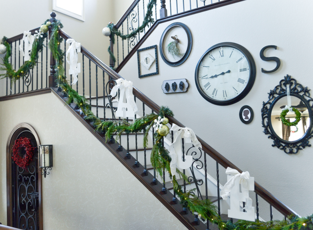 staircase-dressed-for-christmas-in-a-mix-of-fresh-garlands