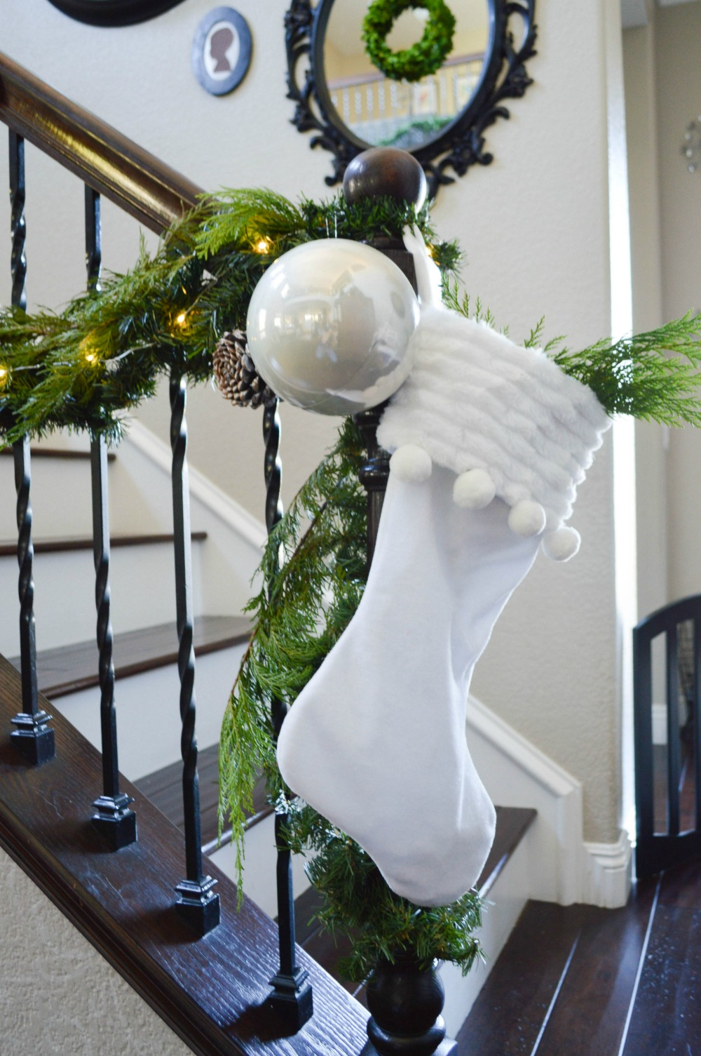 stockings-ornaments-and-garland-for-a-beautiful-stair-banister
