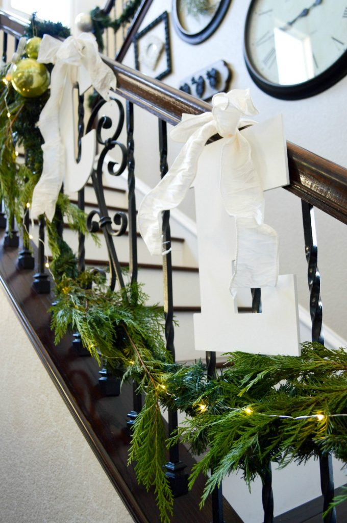 wood-letters-going-up-a-stair-bansiter-for-a-easy-christmas-decoration