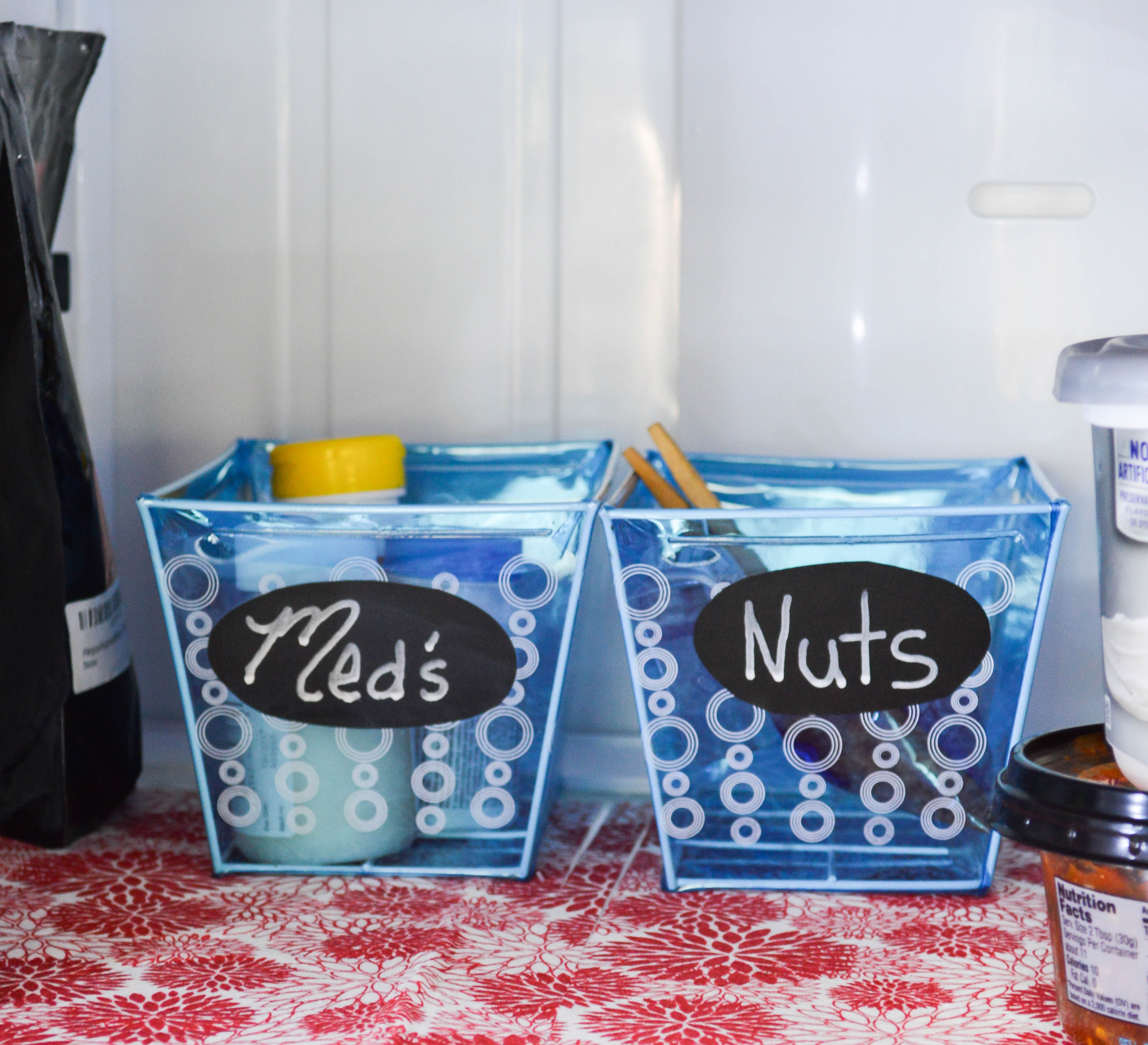 Use bins in the refrigerator to maximize storage space and make it easy on the kids to grab snacks.