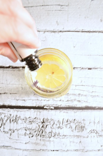 Adding oils, herbs and fruit into a mason jar with a floating candle to keep bugs away at night