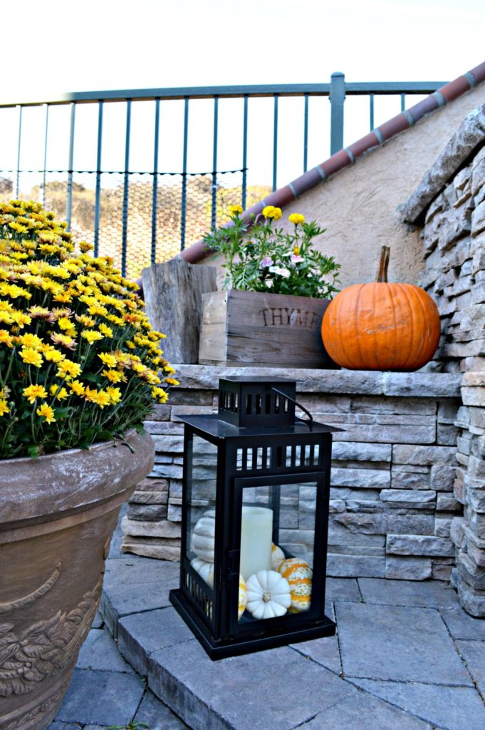 grab those lanterns laying around , add some candles and gourds and you are set for fall!