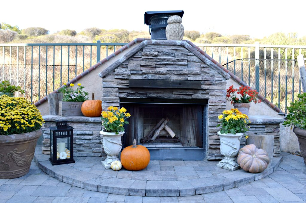 beautiful outdoor stacked stone fireplace