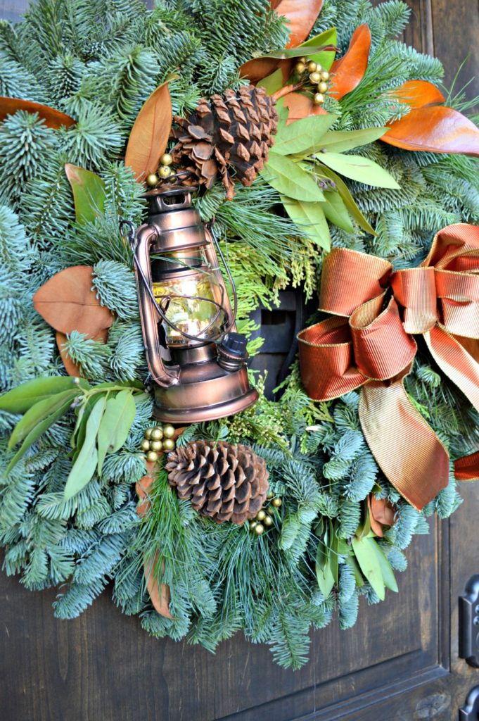 gorgeous fall wreath will magnolia leaves and lantern, so pretty!