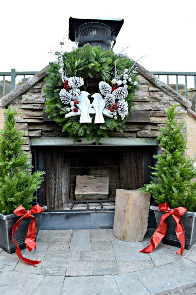 Gorgeous stone fireplace decorated for Christmas with Lynch creek farms wreath