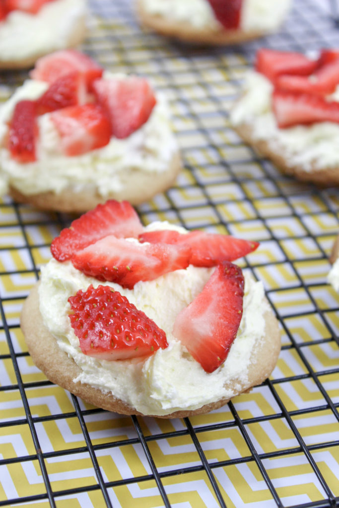 *Directions* - In a large bowl, combine the frozen whipped topping and lemon curd until it's completely mixed. - Use a spoon to scoop a small amount on top of the sugar cookies and spread it so the top is completely covered. - Top with chopped strawberries. - Serve immediately or chill in fridge until ready to serve.