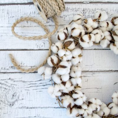 Learn how to make this gorgeous cotton wreath for CHEAP!
