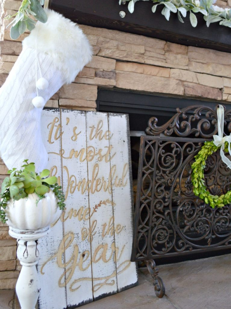 Christmas mantel decorated in white and green