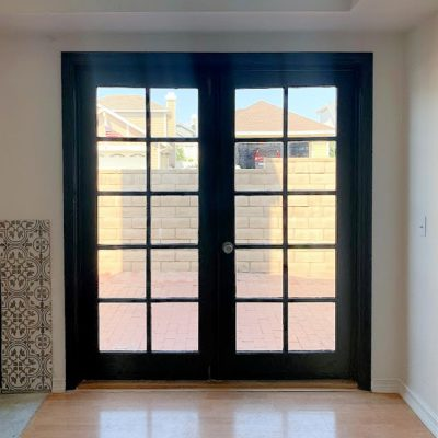 Learn how to paint interior French doors black, the easy way. No sanding or priming. These French Doors will add so much character and charm to your home.